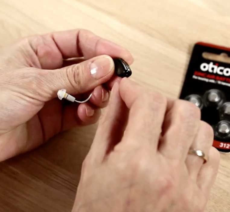 How to insert the battery in behind-the-ear hearing aids